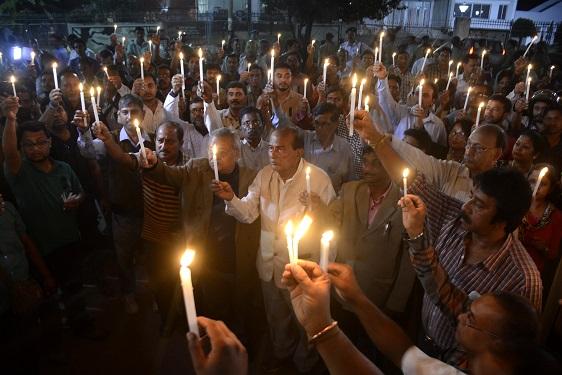 Tripura journalists hold candles demanding  justice during protest rally against murder of their colleagues Sudip Dutta Bhowmik and Sanatanu Bhowmik in Agartala. Photo by Pinaki Das