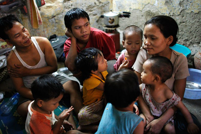 File photo of an extended family of ethnic Chin refugees from Myanmar gather in the living quarters of a relative at a suburb of New Delhi. Photo: Mizzima News