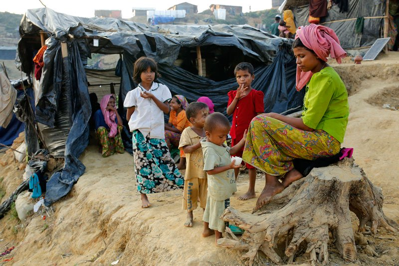 Family members of Rohingya refugees sit in front their tents at Balukhali camp, Ukhiya in Coxsbazar, Bangladesh. (File image)
