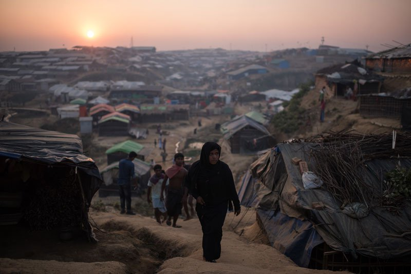 Rohingya Muslim refugees walk through the Kutupalong refugee camp in Cox's Bazar on November 27, 2017. Photo: Mizzima News