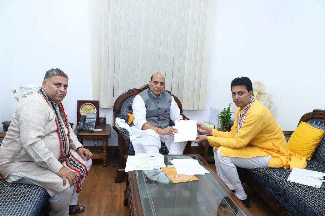 Tripura BJP state president Biplab Deb (R) and central observer Sunil Deodhar meet Union Home Minister Rajnath Singh at New Delhi. File photo