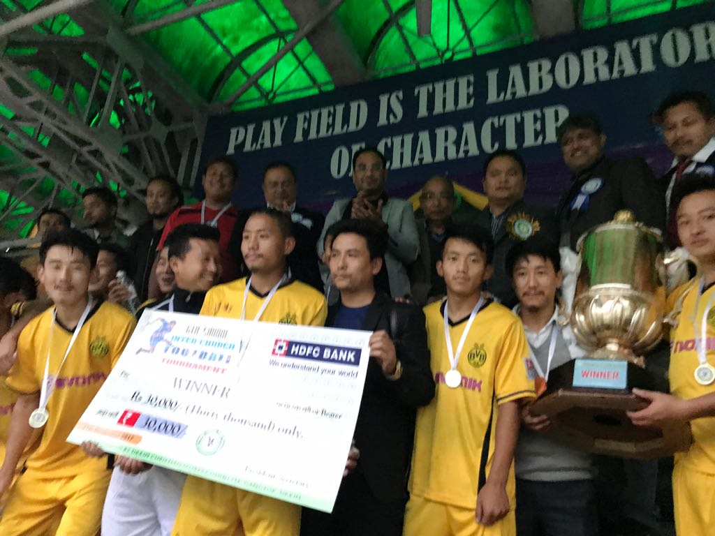 Wok XI players with the champion trophy. Photo by Sagar Chhetri