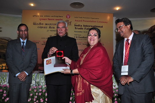 Assam official receiving  award from C R Chaudhury, Union Minister of State for Commerce and Industry in the Award Presentation Ceremony held at Pragati Maidan, New Delhi.