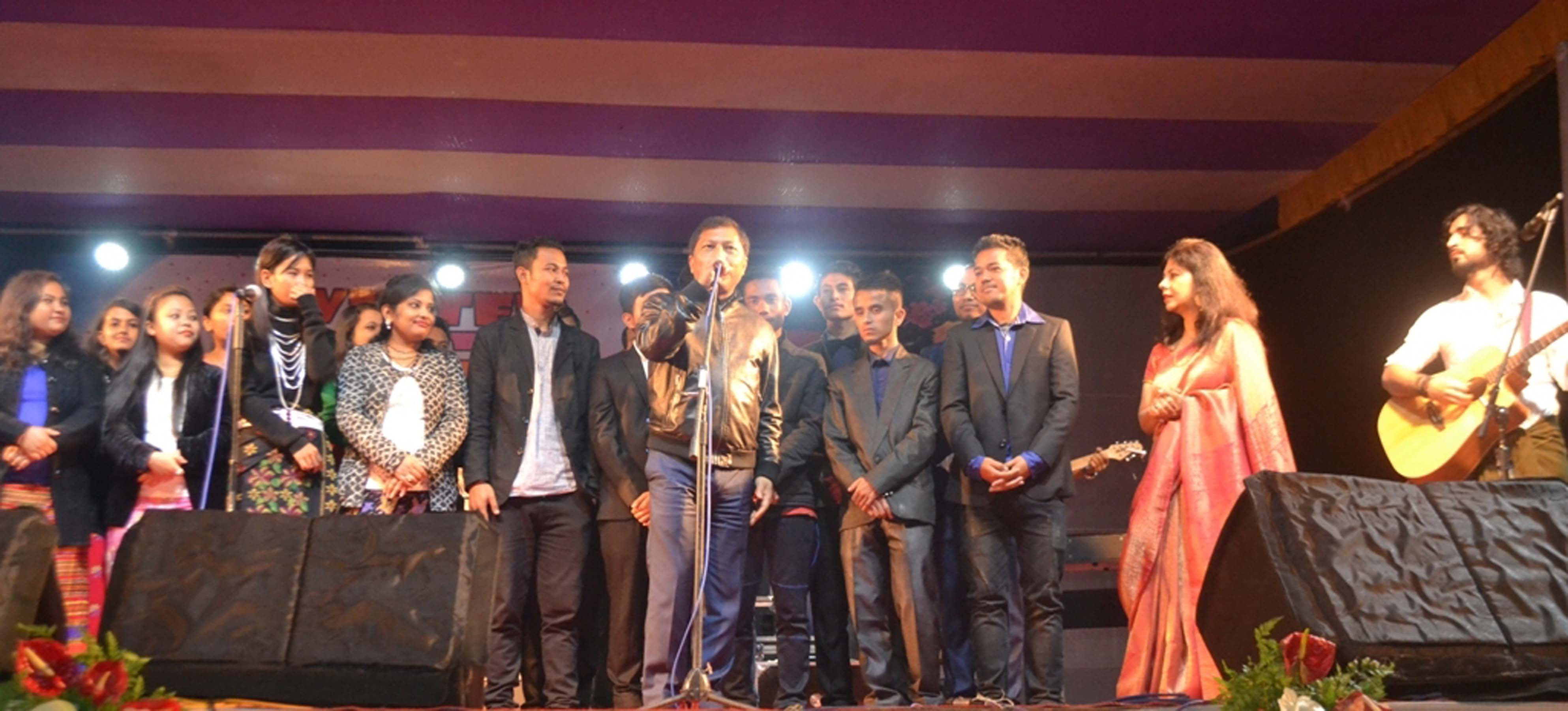 Meghalaya Chief Minister Dr Mukul Sangma joins the team from Centre of Excellence in Classical & Western Music during Tura Winter Youth Festival in Tura. Pix by UB Photos