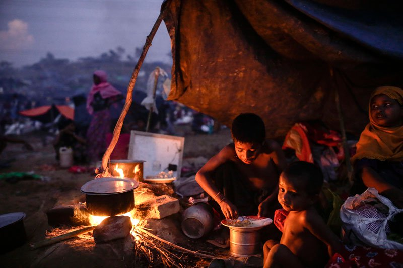 Two Rohingya children eat food at their makeshift tent at Tangkhali, Ukhiya, Bangladesh. Photo : Mizzima News