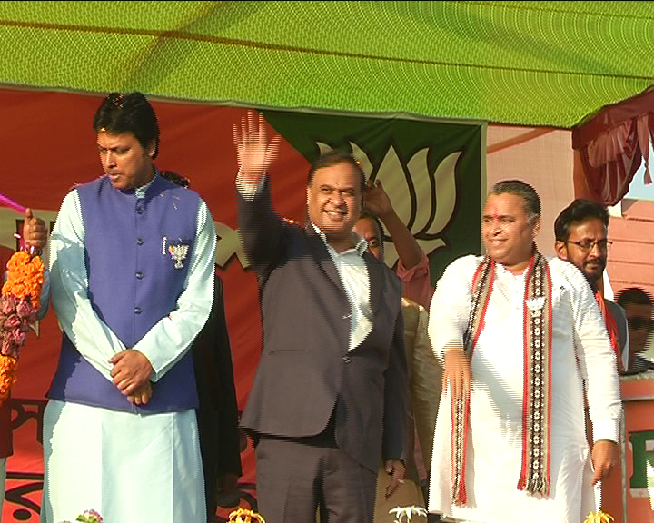 BJP leader Himanta Biswa Sarma waves to the crowd at the election rally in Tripura