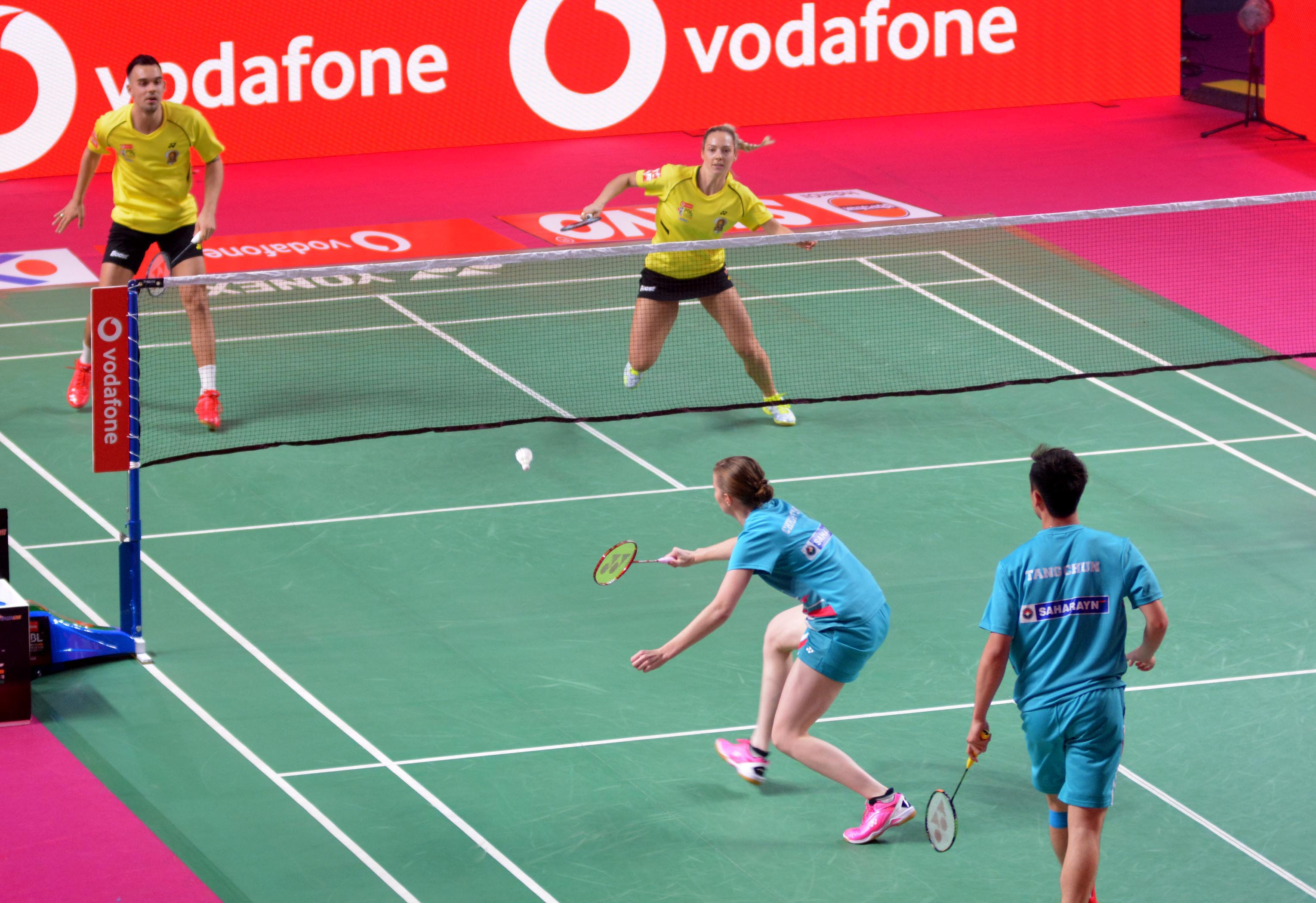 Chennai Smashers pair  Chris Adcock and Gabrielle Adcock played against  Awadhe Warriors pair Christina Pedersen and Tang Chung Man during their mixed doubles tie on  3rd session Vodafone Premier Badminton League match in Guwahati on Saturday, UB Photos