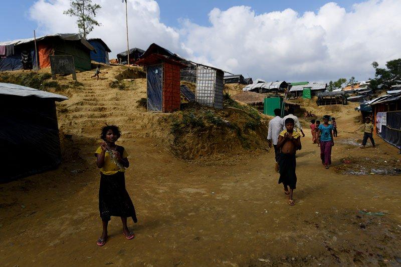 Rohingya children walk through the Balukhali refugee camp near Cox's Bazar, Bangladesh. Photo: Mizzima News