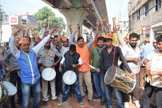 Party workers and supporters celebrating BJP's success in the Gujarat and Himachal state assembly elections outside the BJP headquarter in Agartala on Monday. : Photo: UB Photos