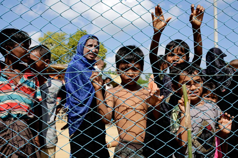 Rohngya refugees including children and women wait outside a fence of a health clinic at the Kutupalong, Coxabazar in Bangladesh. Photo: Mizzima News