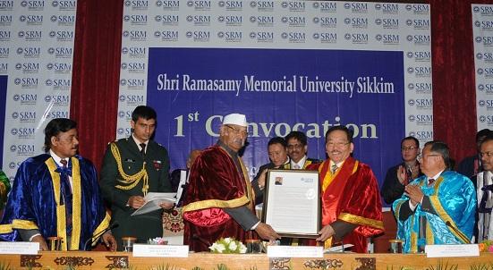 Sikkim CM Pawan Chamling receiving Honourary D Litt degree from Governor Shriniwas Patil in Gangtok on Wednesday. Photo : Sagar Chhetri