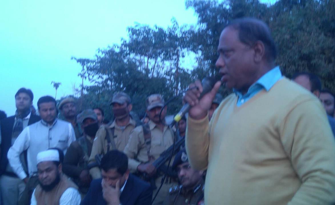 PWD Minister Parimal Suklyabaidya speaking to people during visit to the victim Hasen Ali's house at Atakata in Dhula. Photo credit UB