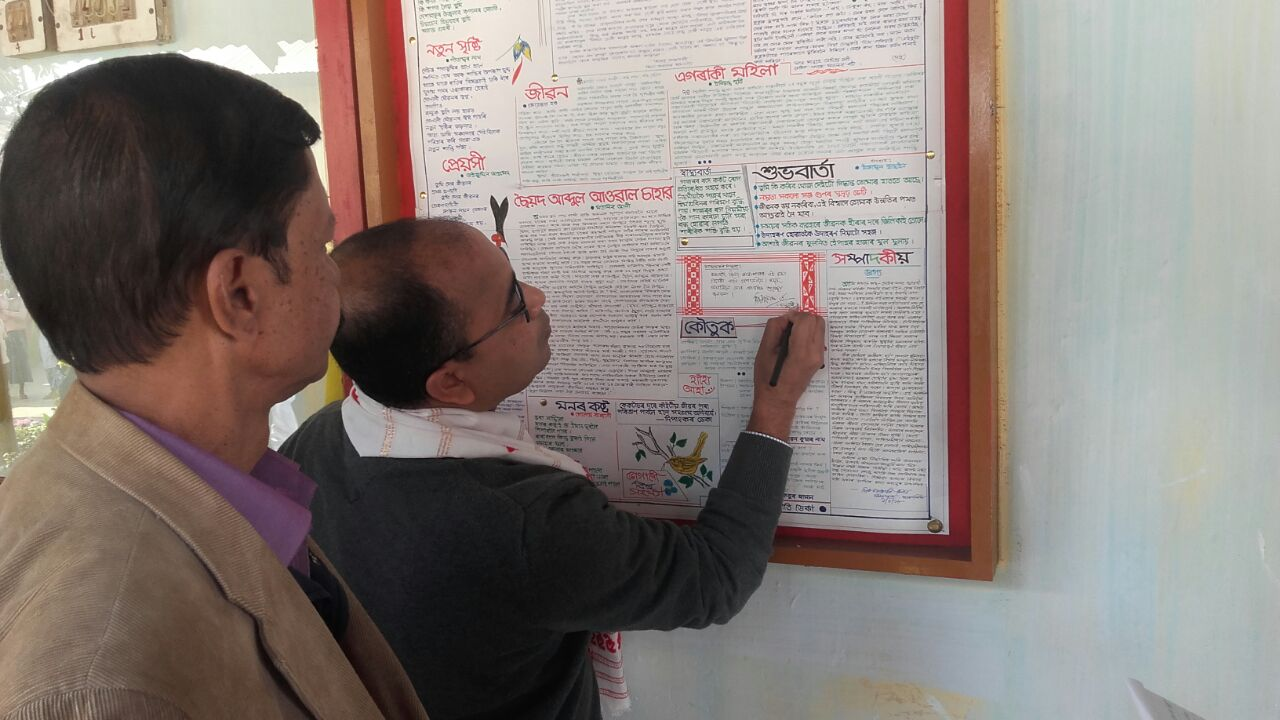 Dr Hiranya Kr Nath writing his comments on the wall magazine