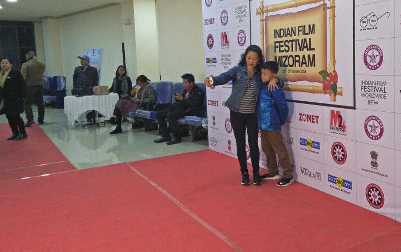 Selfie time for ardent movie fans at the venue of the inaugural ceremony of the Mizoram version of the Indian Film Festival in Aizawl