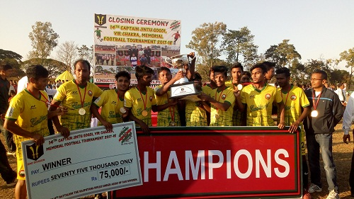 Jorhat Town Club footballers with the Champion trophy.