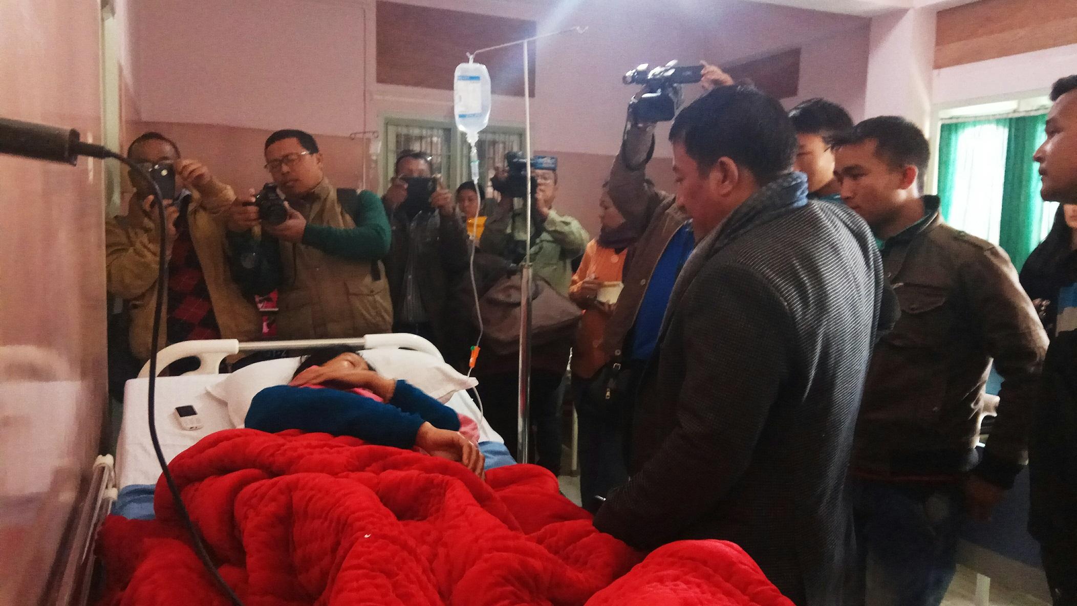 Manipur Town Planning Minister Thounaojam Shyamkumar calling on the blast victim