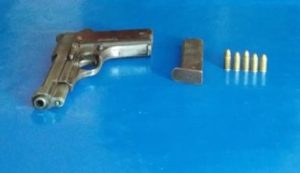 The pistol and ammunition recovered from Bhagin.
