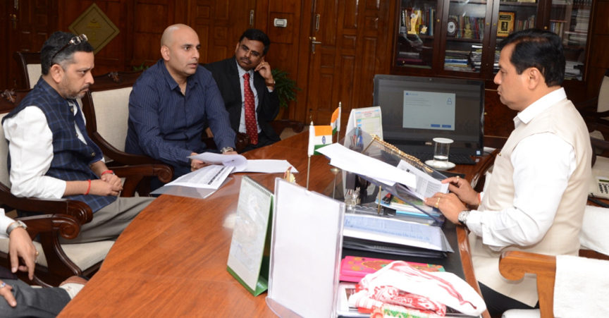 Chief Minister Sarbanadna Sonowal in a meeting with CEO, Air Asia, Amar Abrol at his office chamber in Janata Bhawan.
