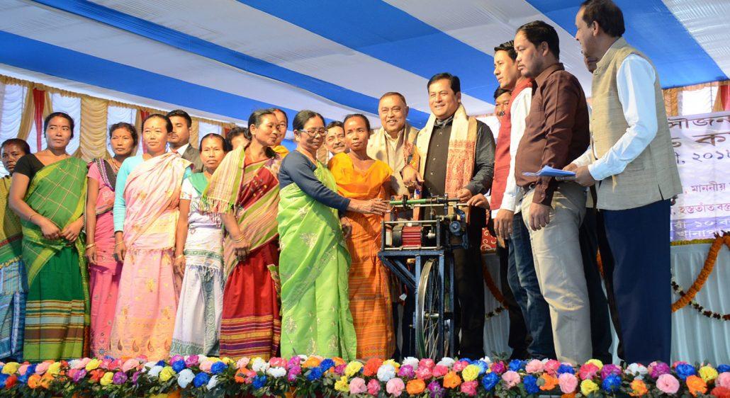 Sarbananda Sonowal distributing equipment to SHGs at Muga Fair and workshop organised at Khanapara on Saturday.