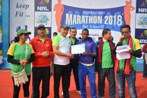 The winner of 21.1 km Numaligarh Marathon, James Ndii Nyawari of Kenya, receiving prize from MD NRL.