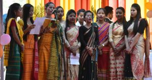 Students performing a chorus at the open session of Tangla College.