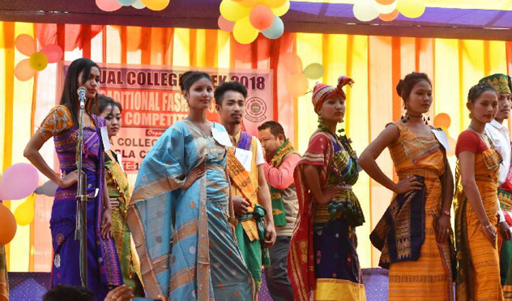 Students participating in a traditional fashion show competition at Tangla College on Saturday.