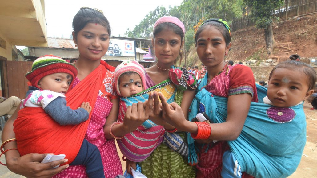 Women voters along with their children after casting votes in Meghalaya.
