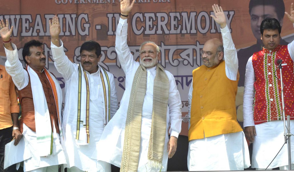 File photo of Prime Minister Narendra Modi, BJP National President Amit Shah with other dignitaries weaving hands to the public during the swearing-in ceremony of Biplab Kumar Deb as Chief Minister of the north-eastern state of Tripura in Agartala on 09-03-18. Pix by UB Photos