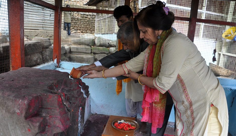 Arunachal Governor BD Mishra and the First Lady offering prayers at Malinithan in Lower Siang district.
