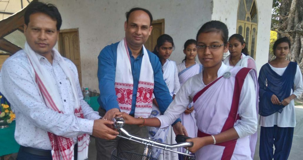 Mangaldai MLA Gurujyoti Das in presence ADC, Darrang Narnarayan Nath, handing over a bicycle to a beneficiary student.