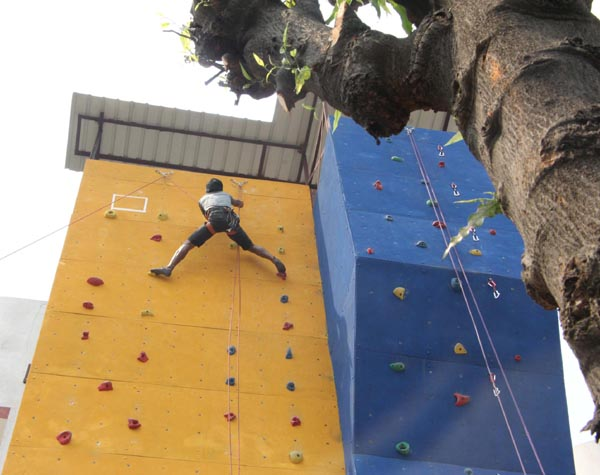 Participants busy in climbing at the opening of Artificial Rock Climbing Wall in Indian Institute of Entrepreneurship (IIE) in Guwahati