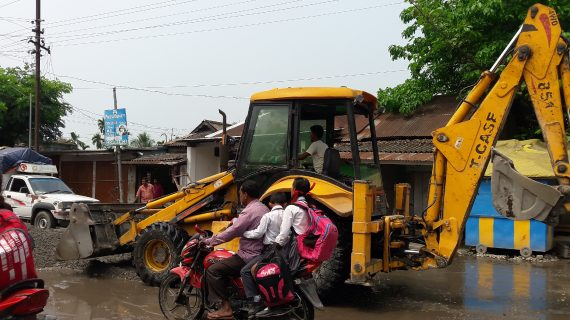 A JCB pressed into action on the Tangla-Bhergaon road in Tangla on Saturday.
