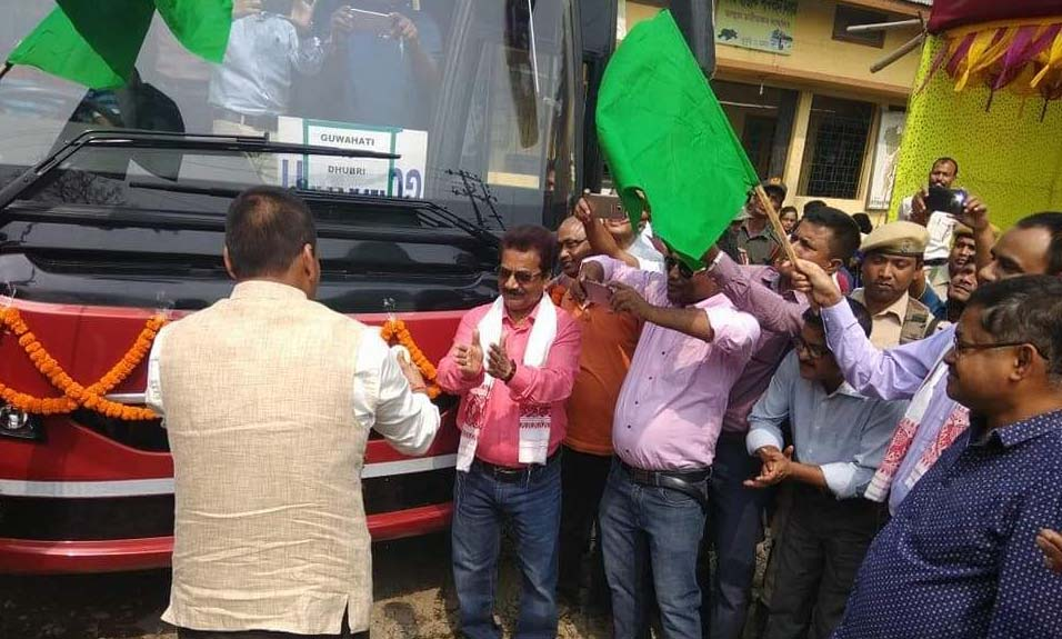 The Volvo bus service being flagged-off in Dhubri.