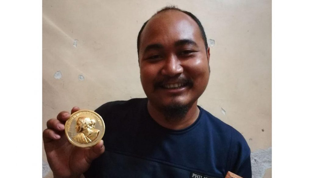 Bikram Narzary with the medal.