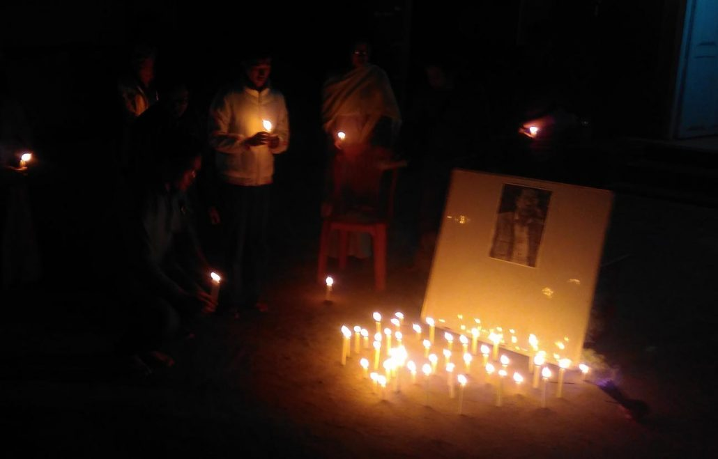 Candles being lit at the Manipur Press Club as a mark of respect to the departed soul.