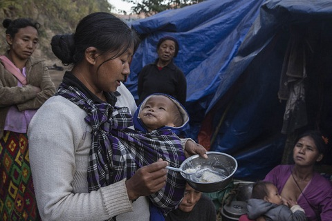 A mother feeding her baby at a refugee camp near Lung Byeng village, Waimaw township in Kachin state. Picture credit: Mizzima News