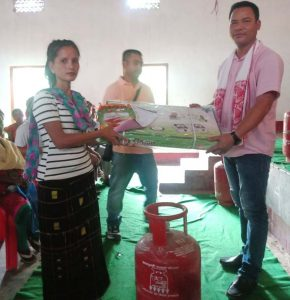 LPG set being handed over to a beneficiary in Dima Hasao.