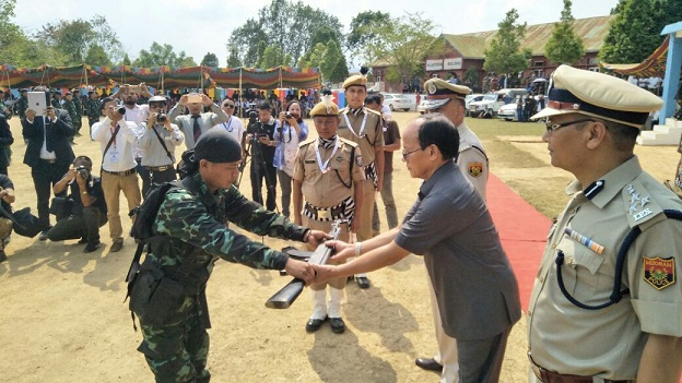 File photo: An HPC-D member surrendering arm to Mizoram home minister R Lalzirliana at Sesawng in Mizoram on April 13, 2018.  Northeast Now