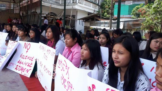 Women wing volunteers of All Manipur Students' Union (AMSU) stage sit-in demonstration in Imphal on Monday.