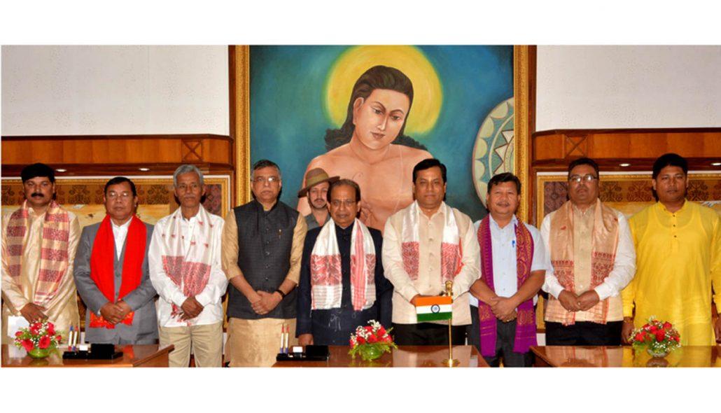 Assam Governor Prof Jagdish Mukhi, CM Sarbananda Sonowal posing for a group photograph with the new ministers at Raj Bhawan, Guwahati on Thursday. Photo credit: UB Photos