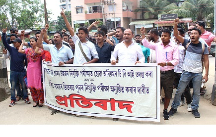 Candidates taking out a protest against irregularity in P&RD recruitment exam and demanding re-examination at Guwahati on May 24, 2018. UB Photos