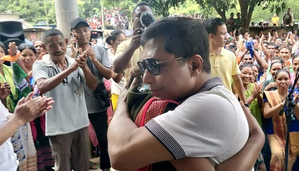 Former Meghalaya CM Mukul Sangma hugging his daughter Miani D Shira after her win against NPP candidate in Ampati by-poll. Photo: Northeast Now