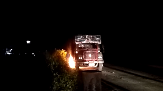 A truck set on fire by irate locals after it killed a youth. Northeast Now