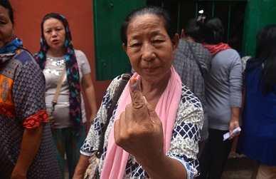 A woman voter shows her ink mark on her finger after casting her vote during the Lok Shabha by-election in Dimapur, Nagaland on  May 28,  2018. Photo: Caisii Mao