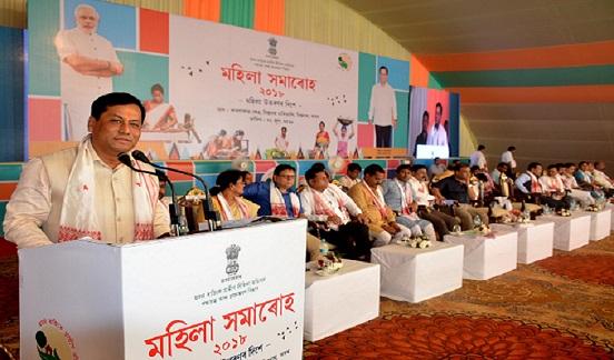 Chief Minister Sarbananda Sonowal speaking  at a Mahila Samaroh held at Kamala Kanta Kshetra in Biswanath on June 27, 2018. UB Photos