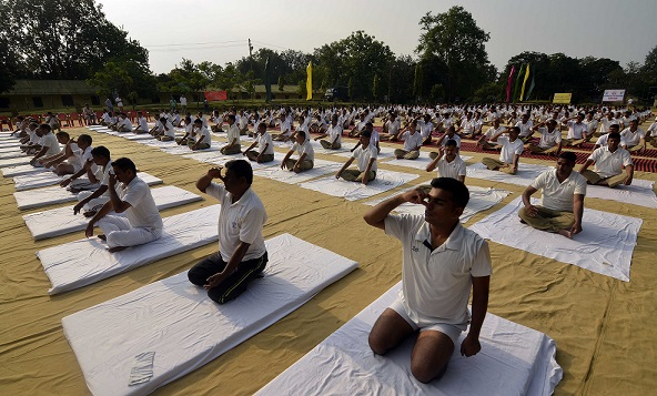 BSF jawans during a  Yoga session to mark the International Yoga Day at Panisagar BSF Headquarter in north Tripura on June 21, 2018. Photo: Panna Ghosh.