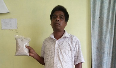 Arrested peddler Jeram Purti with the brown sugar packet. Photo Credit - Northeast Now