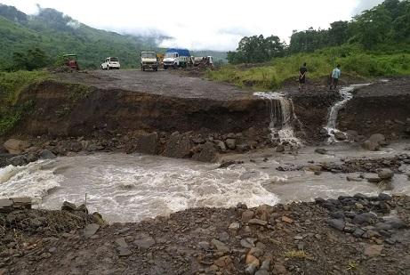 Flood waters wash away road in Dima Hasao. Photo: Pankaj Kumar Deb