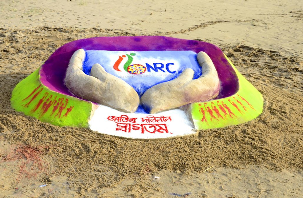 FIle photo of artist Ranjan Saikia making a NRC logo replica ahead of publication of the final National Register of Citizens (NRC) draft at the bank of River Brahmaputra under Dhekiajuli in Sonitpur district. Photo by UB Photos