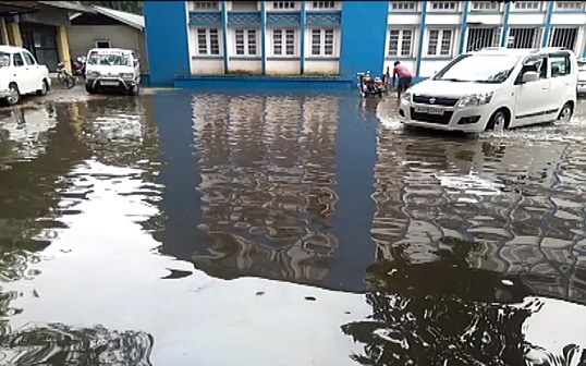 Rain water submerges office of deputy commissioner at Mangaldai town on July 13, 2018. Photo: Mayukh Goswami
